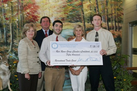 photo of Paul and Matt accepting the check