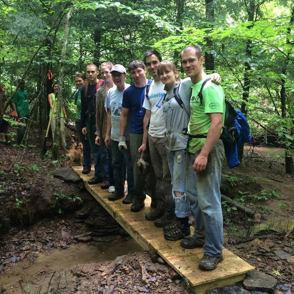 Photo of trail day volunteers on a newly built footbridge