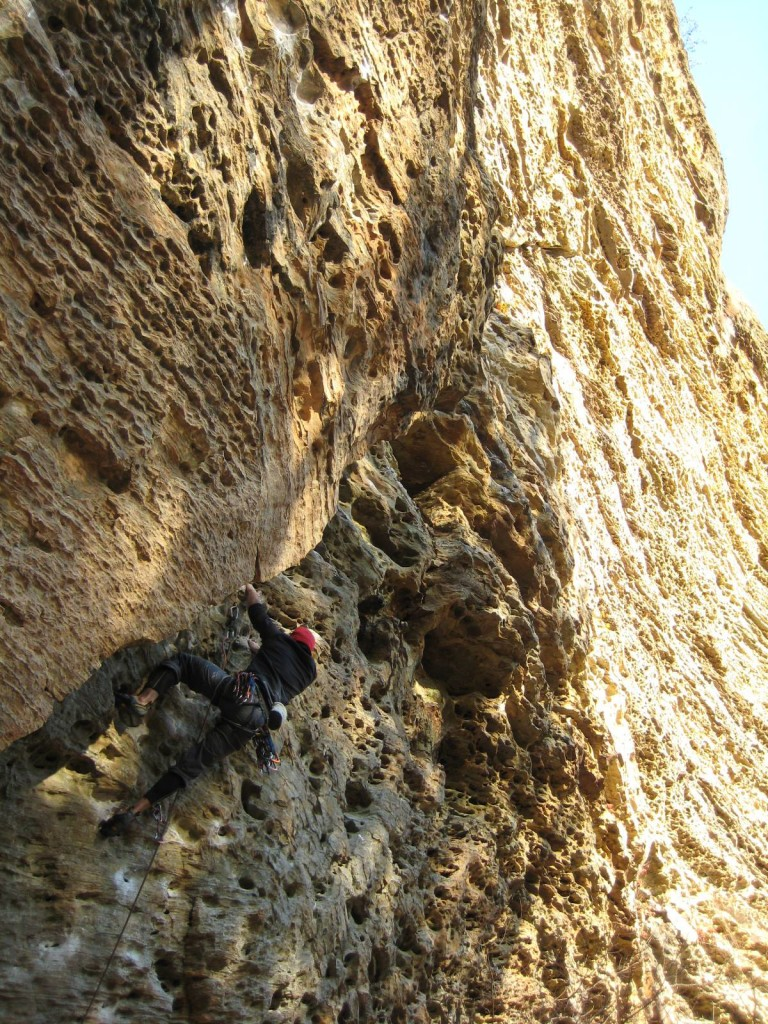 photo of a person climbing